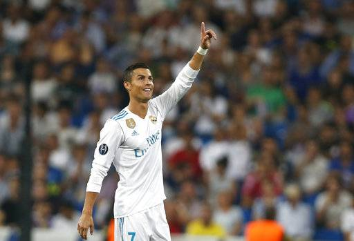 Real Madrid's Cristiano Ronaldo celebrates scoring his side's 2nd goal during a Champions League group H soccer match between Real Madrid and Apoel Nicosia at the Santiago Bernabeu stadium in Madrid, Spain, Wednesday, Sept. 13, 2017. (AP Photo/Francisco Seco)