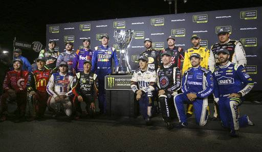 In this Saturday Sept. 9, 2017, photo, the Chase drivers (top row) Chase Elliott, from left, Austin Dillon, Denny Hamlin, Kyle Busch, Martin Truex Jr., Kurt Busch, Matt Kenseth, Ryan Newman, (bottom row) Kyle Larson, from left, Jamie McMurray, Ryan Blaney, Kasey Kahne, Brad Keselowski, Kevin Harvick, Ricky Stenhouse Jr., and Jimmie Johnson pose for a photo following the Federated Auto Parts 400 in Richmond, Va. (Shelby Lum/Richmond Times-Dispatch via AP)
