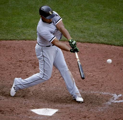 Chicago White Sox's Jose Abreu hits a sacrifice fly to score the go-ahead run during the ninth inning of a baseball game against the Kansas City Royals on Wednesday, Sept. 13, 2017, in Kansas City, Mo. The White Sox won 5-3. (AP Photo/Charlie Riedel)