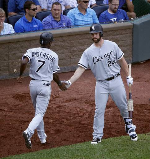 Chicago White Sox's Tim Anderson (7) celebrates with Matt Davidson (24) after scoring on a sacrifice fly by Jose Abreu during the ninth inning of a baseball game against the Kansas City Royals Wednesday, Sept. 13, 2017, in Kansas City, Mo. The Chicago White Sox won 5-3.