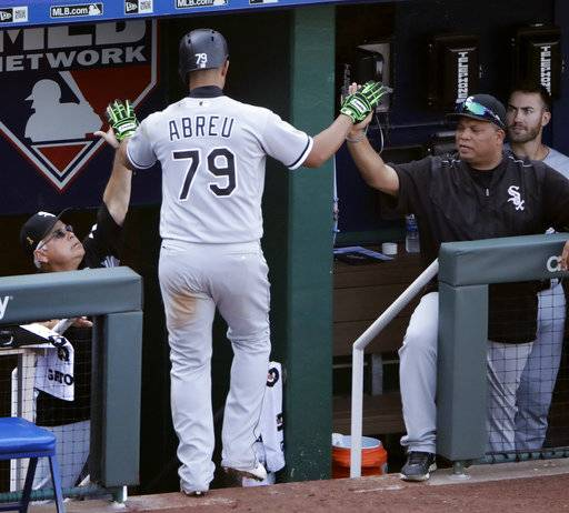 Chicago White Sox's Jose Abreu celebrates going into the dugout after hitting a sacrifice fly to score the go-ahead run during the ninth inning of a baseball game against the Kansas City Royals Wednesday, Sept. 13, 2017, in Kansas City, Mo. The Chicago White Sox won 5-3.