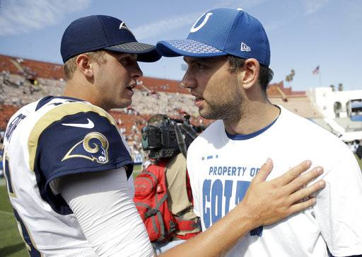 Los Angeles Rams quarterback Jared Goff, left, greets injured Indianapolis Colts quarterback Andrew Luck after an NFL football game Sunday, Sept. 10, 2017, in Los Angeles. (AP Photo/Jae C. Hong)