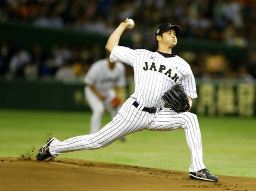 FILE - In this Nov. 19, 2015, file photo, Japan's starter Shohei Otani pitches against South Korea during the first inning of their semifinal game at the Premier12 world baseball tournament at Tokyo Dome in Tokyo. Shohei Otani is likely to leave Japan and sign with a Major League Baseball team after this season, multiple reports in Japanese media said Wednesday, Sept. 13, 2017, a move that would cost the 23-year-old pitcher and outfielder more than $100 million. (AP Photo/Toru Takahashi, File)