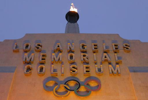 A blazing Olympic cauldron is seen at the Los Angeles Memorial Coliseum on Wednesday, Sept. 13, 2017. The cauldron was lit early Wednesday morning at the stadium that was the site of the 1932 and 1984 Olympics. An International Olympic Committee meeting in Peru is to make it official that LA will host in 2028 and that the 2024 Games will go to Paris.