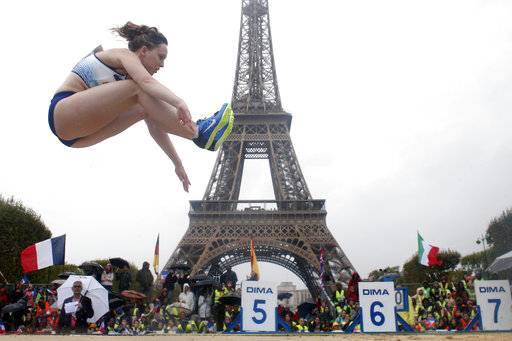 British athlete Rebecca Chapman performs a high jump in front of the Eiffel Tower ahead of the vote in Lima, Peru, awarding the 2024 Games to the French capital, on the Champs de Mars garden in Paris, France, Wednesday, Sept. 13, 2017. Paris is certain of getting the 2024 Olympics so it has been able to plan its celebrations in advance. The International Olympic Committee is expected to confirm the award later Wednesday.