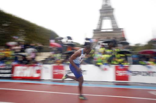 British athlete James Dasaolu competes in a men's 100m heat in front of the Eiffel Tower ahead of the vote in Lima, Peru, awarding the 2024 Games to the French capital, on the Champs de Mars garden in Paris, France, Wednesday, Sept. 13, 2017. Paris is certain of getting the 2024 Olympics so it has been able to plan its celebrations in advance. The International Olympic Committee is expected to confirm the award later Wednesday.