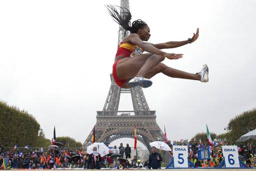 Nigerian-born Spanish athlete Juliet Itoya performs a high jump in front of the Eiffel Tower ahead of the vote in Lima, Peru, awarding the 2024 Games to the French capital, on the Champs de Mars garden in Paris, France, Wednesday, Sept. 13, 2017. Paris is certain of getting the 2024 Olympics so it has been able to plan its celebrations in advance. The International Olympic Committee is expected to confirm the award later Wednesday.
