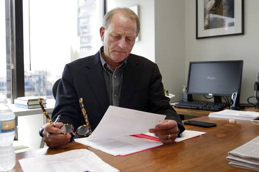 """60 Minutes"" Executive Producer Jeff Fager looks over a list of story proposals in his office, in the ""60 Minutes"" offices, in New York, Tuesday, Sept. 12, 2017.   CBS' ""60 Minutes,"" the newsmagazine that can credit consistency for much of its success as it enters its 50th anniversary year."