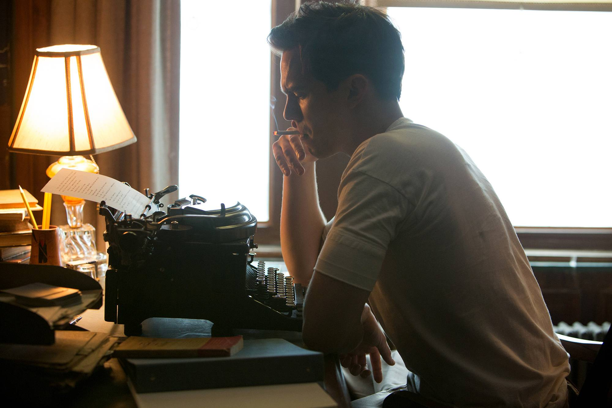 "J.D. Salinger (Nicholas Hoult) creates the iconic Holden Caulfield in ""Rebel in the Rye."""