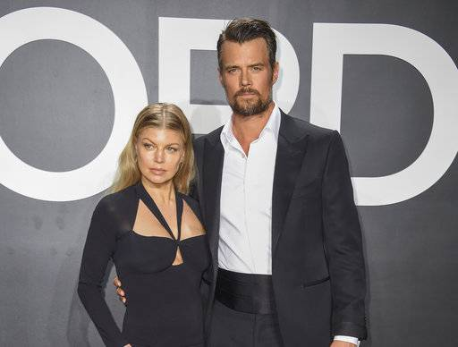 "FILE - In this Feb. 20, 2015 file photo, singer Fergie, left, and actor Josh Duhamel arrive at the Tom Ford Autumn/Winter 2015 Womenswear Presentation in Los Angeles. The actor and singer confirmed that they'd decided to split up earlier this year but kept the news quiet ""to give our family the best opportunity to adjust.� (Photo by Rob Latour/Invision/AP, File)"
