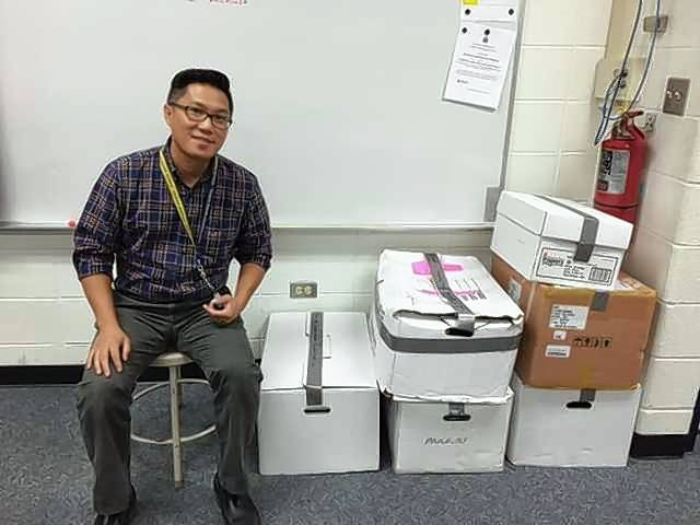 Ruel Apostol, sixth-grade science teacher at Bernotas Middle School in Crystal Lake, has started a book drive to help Murphy Elementary School, whose library and classroom books were destroyed after heavy rains and flooding in July in Round Lake Park.