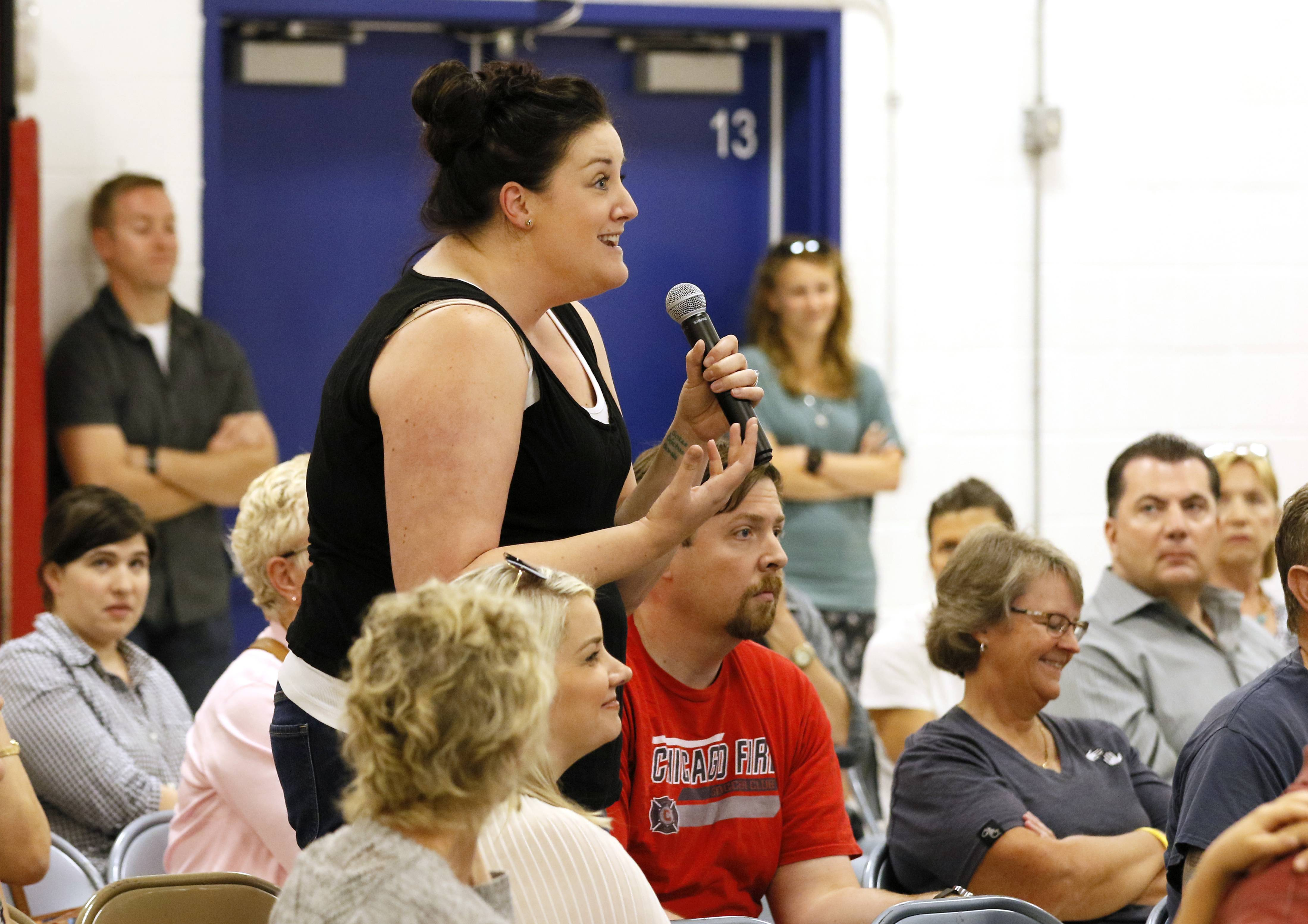 Kate Gibson was one of many residents who voiced opinions Thursday night about the noxious smell coming from the Glenbard Wastewater Treatment Authority facility. Gibson and her family recently purchased a house near the plant.