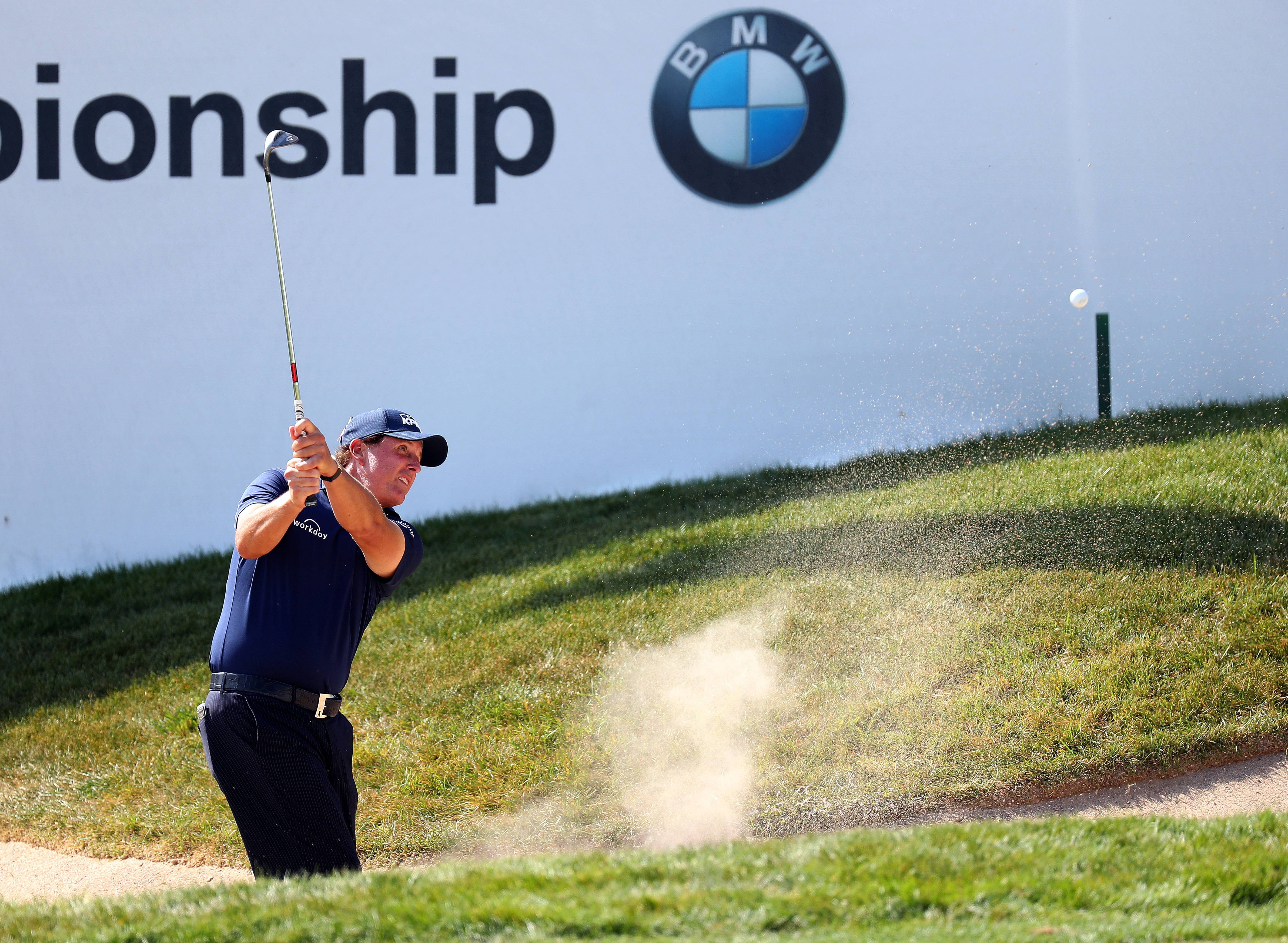 Phil Mickelson hits out of the bunker on 18 during the first round of the BMW Championship at Conway Farms Golf Course in Lake Forest Thursday, September 14, 2017.