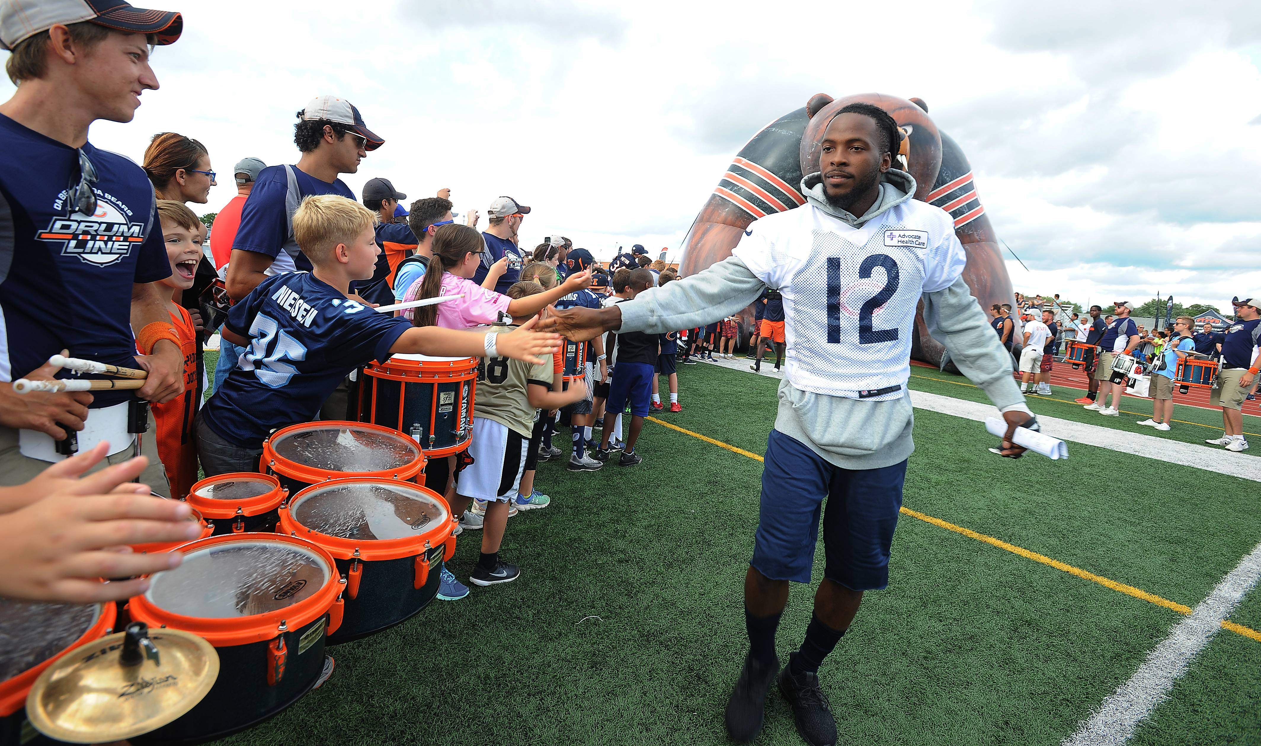 The Chicago Bears and player Markus Wheaton invade the George Gattas Memorial Stadium football field at Prospect High School for a rare practice in front of thousands of their fans.