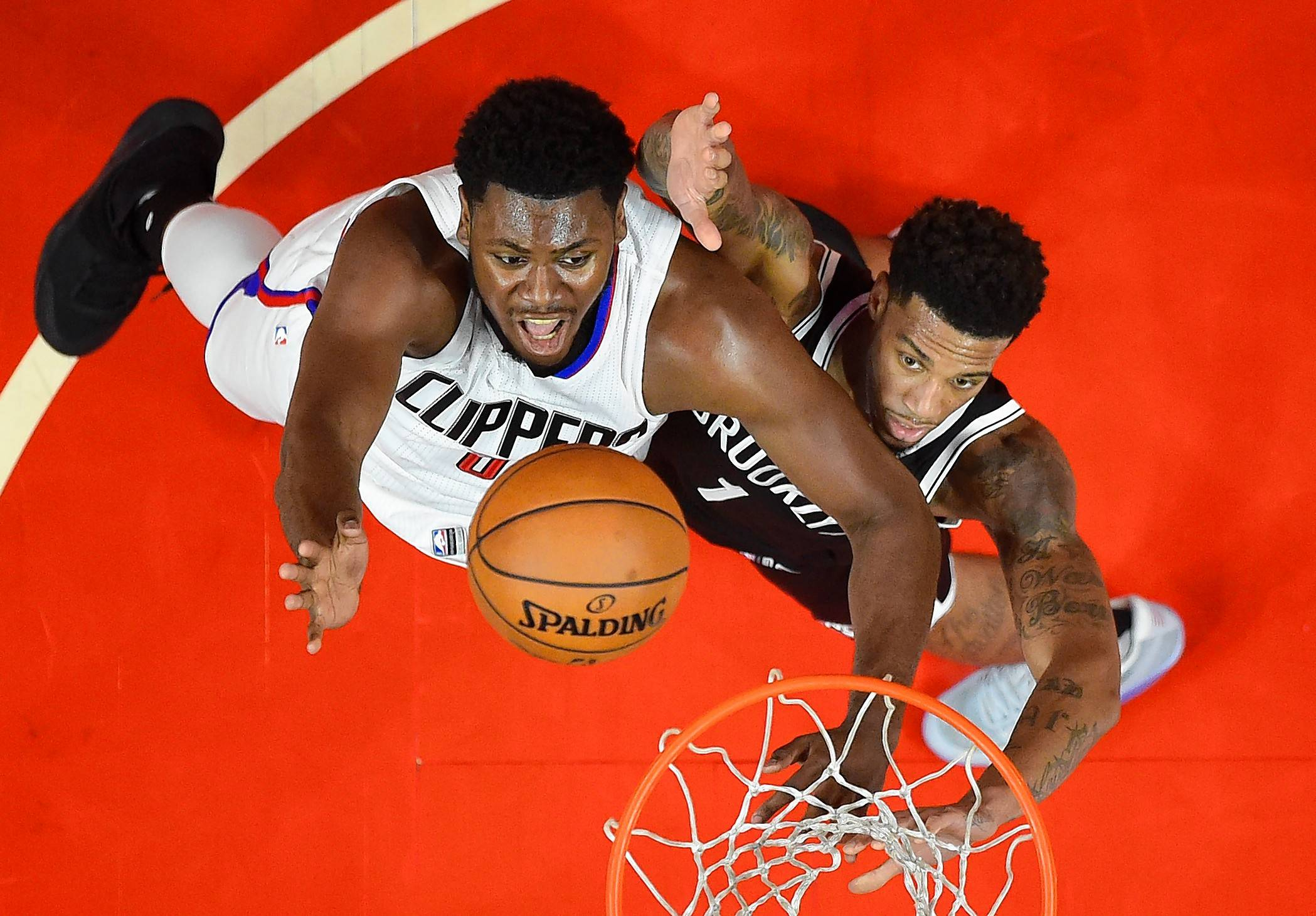 Former Los Angeles Clippers center Diamond Stone, left, has signed a contract with the Chicago Bulls, who likely will try to develop him on their G-League team, the Windy City Bulls.