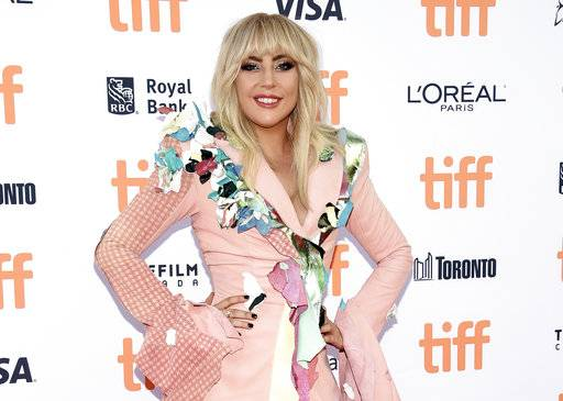 "FILE - In this sept. 8, 2017 file photo, Lady Gaga attends a premiere for ""Gaga: Five Foot Two"" at the Toronto International Film Festival in Toronto. Lady Gaga has been hospitalized and forced to pull out of the upcoming Rock in Rio music festival in Brazil, citing ""severe physical pain� and posting a photo of what resembles an IV in her arm. (Photo by Evan Agostini/Invision/AP, File)"