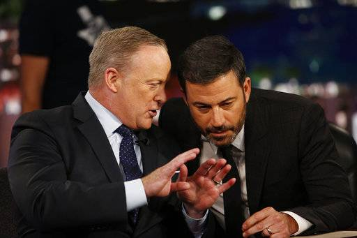 "In this Sept. 13, 2017 photo released by ABC, former White House Press Secretary Sean Spicer Sean Spicer, left, appears with host Jimmy Kimmel on ""Jimmy Kimmel Live,"" in Los Angeles. (ABC via AP)"