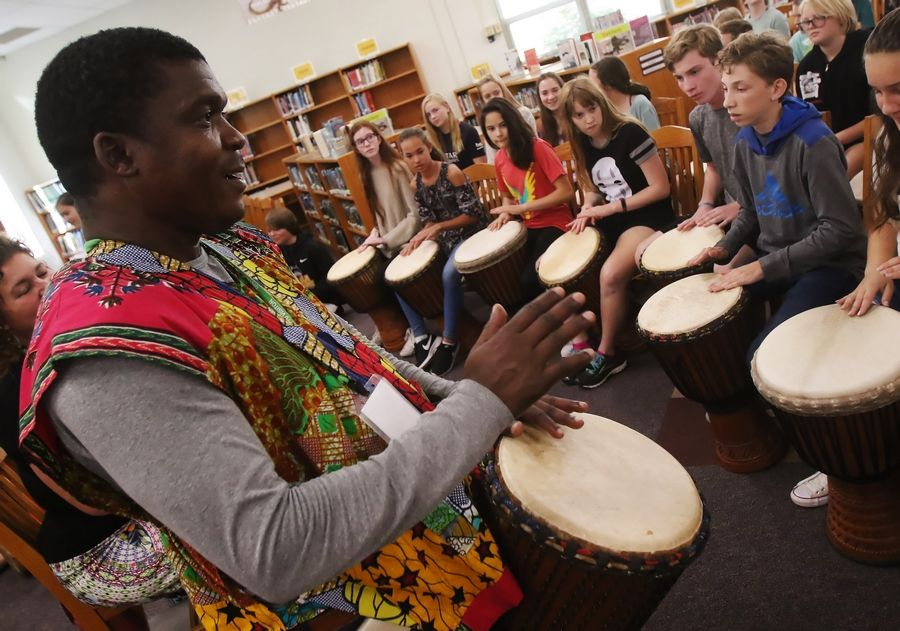 West African musician Fode Camara teaches students how to play African drums Thursday at Highland Middle School in Libertyville. Camara and Helen Bond of the Benkadi Project provided instruction on the drums as part of a cultural learning experience.