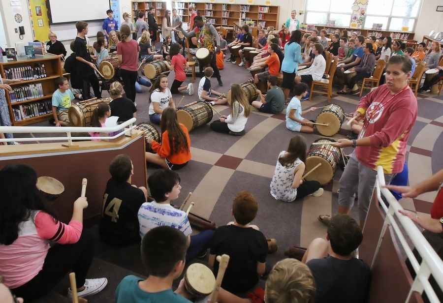 Students learned to play African drums in the Learning Center Thursday at Highland Middle School in Libertyville. West African musician Fode Camara and Helen Bond of the Benkadi Project provided instruction on the drums as part of a cultural learning experience.