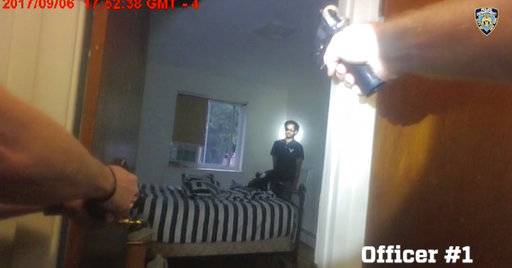 CORRECTS DATE TO 6TH, NOT 7TH- In this Sept. 6, 2017, image taken from a New York Police Department officer's body camera video, officers aim their weapons towards Miguel Richards as Richards kneels on his bed in his New York apartment while holding a knife. The officers shot and killed Richards after he pointed a gun at them that turned out to be fake. Release of the body cam video marked the first fatal police encounter captured on the devices since officers started wearing them this year. (New York Police Department via AP)