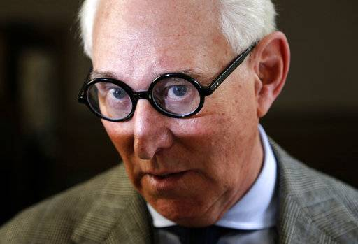 In this March 30, 2017 photo, Roger Stone talks to reporters outside a courtroom in New York. Stone, a longtime adviser to President Trump, says he will appear before the House intelligence committee on Sept. 26. (AP Photo/Seth Wenig)
