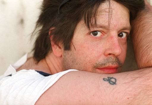 In this May 2000 photo, former Husker Du drummer Grant Hart poses for a photo in Minneapolis. Ken Shipley, who runs the band's record label Numero Group, told The Associated Press that Hart died at the age of 56 on Wednesday, Sept. 13, 2017, of cancer at his home in St. Paul, Minn. (Jeff Wheeler/Star Tribune via AP)