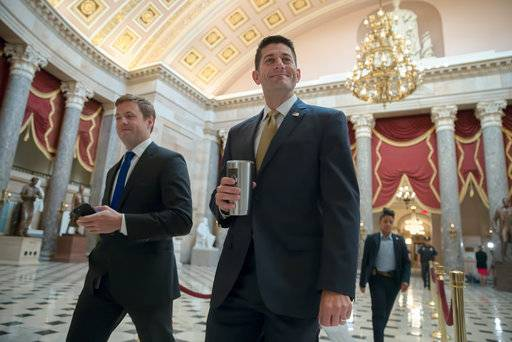 Speaker of the House Paul Ryan, R-Wis., right, walks to his office before a vote at the Capitol in Washington, Thursday morning, Sept. 14, 2017. (AP Photo/J. Scott Applewhite)