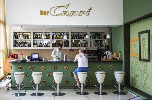 "In this Sept. 12, 2017, photo, a customer sits at the lobby bar of the Hotel Capri in Havana, Cuba. New details about a string of mysterious ""health attacks� on U.S. diplomats in Cuba indicate the incidents were narrowly confined within specific rooms or parts of rooms. Aside from their homes, officials said Americans were attacked in at least one hotel, the recently renovated Hotel Capri, steps from the Malecon, Havana's iconic, waterside promenade."