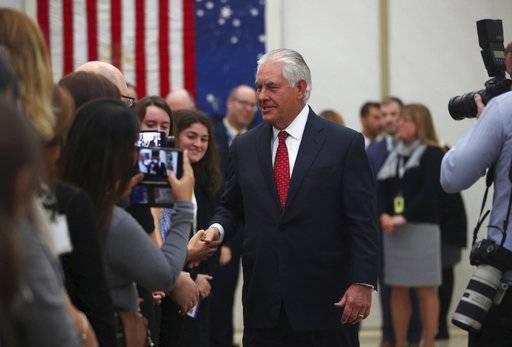 U.S. Secretary of State Rex Tillerson shakes hands with staff, at the U.S Embassy in London, Thursday, Sept. 14, 2017, during his second visit to Britain since taking office in February. (Hannah McKay/Pool Photo via AP)