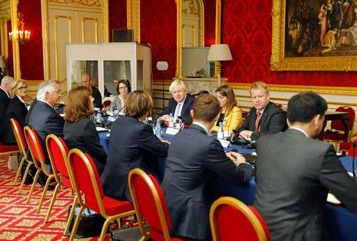 Britain's Foreign Secretary Boris Johnson, centre, sits opposite US Secretary of State Rex Tillerson, four left, ahead of their meeting, in London, Thursday, Sept. 14, 2017. Secretary of State Rex Tillerson is in London for talks Thursday on international efforts to pressure North Korea over its nuclear and missile programs, and on the chaos in Libya.(Tolga Akmen/Pool Photo via AP)