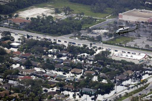 Marine One, with President Trump aboard, flies over areas impacted by Hurricane Irma, Thursday, Sept. 14, 2017, in Naples, Fla.