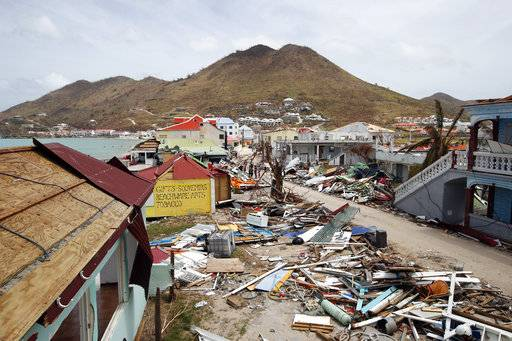 View of the partially buildings destroyed by Irma during the visit of France's President Emmanuel Macron in the French Caribbean islands of St. Martin, Tuesday, Sept. 12, 2017. Macron is in the French-Dutch island of St. Martin, where 10 people were killed on the French side and four on the Dutch.