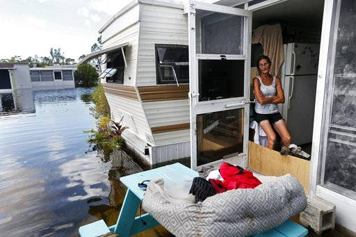 Cherie Ethier sits in her mobile home with her pets surrounded by floodwater, in the Marco Naples RV Resort in the aftermath of Hurricane Irma, in Naples, Fla., Tuesday, Sept. 12, 2017.