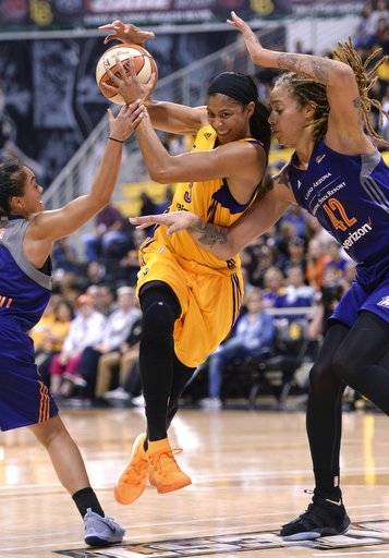 Los Angeles Sparks' Candace Parker (3) drives between Phoenix Mercury's Emma Cannon, left, and Brittany Griner (42) during the first half of Game 2 of WNBA basketball playoff semifinal, Thursday, Sept. 14, 2017, in Long Beach, Calif. (Stephen Carr//Los Angeles Daily News via AP)