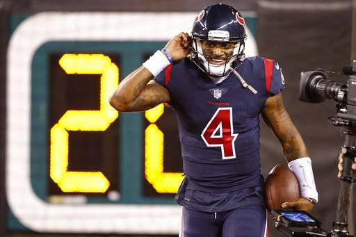 Houston Texans quarterback Deshaun Watson smiles after scoring a touchdown during the first half of an NFL football game against the Cincinnati Bengals, Thursday, Sept. 14, 2017, in Cincinnati. (AP Photo/Gary Landers)
