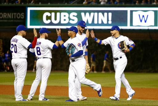 The Chicago Cubs celebrate the team's 14-6 win over the New York Mets in a baseball game Thursday, Sept. 14, 2017, in Chicago. (AP Photo/Charles Rex Arbogast)