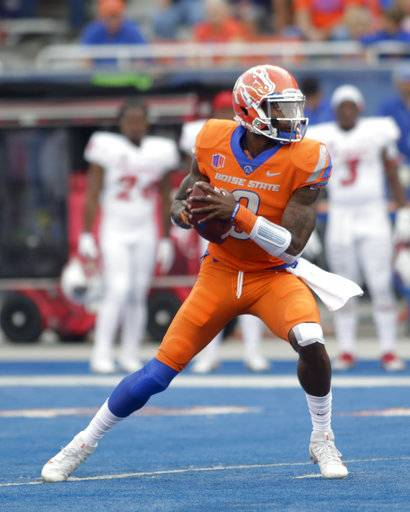 Boise State quarterback Montell Cozart (3) looks for a receiver during the first half of an NCAA college football game against New Mexico in Boise, Idaho, Thursday, Sept. 14, 2017. (AP Photo/Otto Kitsinger)
