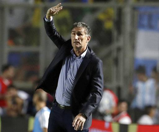 FILE - In this Nov. 15, 2016, file photo, then Argentina's coach Edgardo Bauza gives instructions to his players during a 2018 World Cup qualifying soccer match against Colombia in San Juan, Argentina. Bauza replaced Bert van Marwijk as head coach of Saudi Arabia just days after the Dutchman led the team to its first qualifying spot at a World Cup since 2006. A win over Japan on Sept. 5, 2017 sealed Saudi Arabia's place at Russia in 2018, but van Marwijk, who took the job in 2015, and the Saudi Arabia Football Federation (SAFF) were unable to agree on a new contract. (AP Photo/Natacha Pisarenko, File)