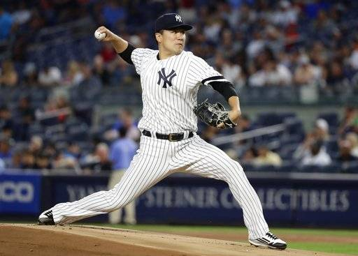 New York Yankees' Masahiro Tanaka throws during the first inning of a baseball game against the Baltimore Orioles Thursday, Sept. 14, 2017, in New York. (AP Photo/Frank Franklin II)