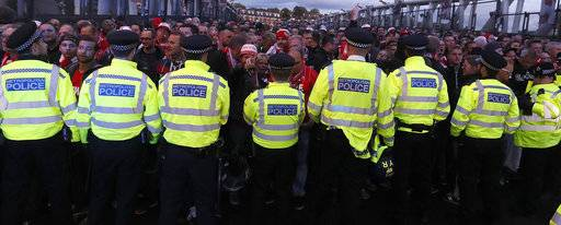 Police forces block Cologne supporters outside the Emirates stadium prior to the Europa League group H soccer match between Arsenal and FC Cologne at the Emirates stadium in London, England, Thursday, Sept. 14, 2017 . (AP Photo/Kirsty Wigglesworth)