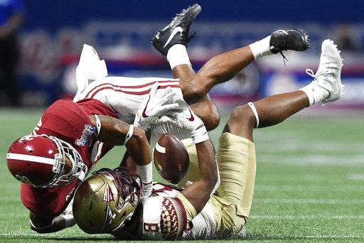 FILE - In this Sept. 2, 2017, file photo, Florida State wide receiver Nyqwan Murray (8) misses the catch as Alabama's Anthony Averett (28) defends during the first half of an NCAA football game, Saturday, Sept. 2, 2017, in Atlanta. For all the talk of Alabama's five-star recruits, some unsung guys like converted receiver Anthony Averett and former walk-ons Levi Wallace and Jamey Mosley are also playing key roles.