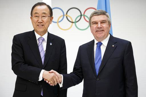 "FILE - In this June 17, 2014, file photo, International Olympic Committee (IOC) president, Thomas Bach, right, shakes hands with United Nations Secretary General, Ban Ki-moon, at the IOC Headquarters in Lausanne, Switzerland. Former United Nations secretary general Ban Ki-moon has been elected chair of the International Olympic Committee's ethics commission. In his acceptance speech Thursday, Sept. 14, 2017, Ban called his new task ""a serious responsibility."""