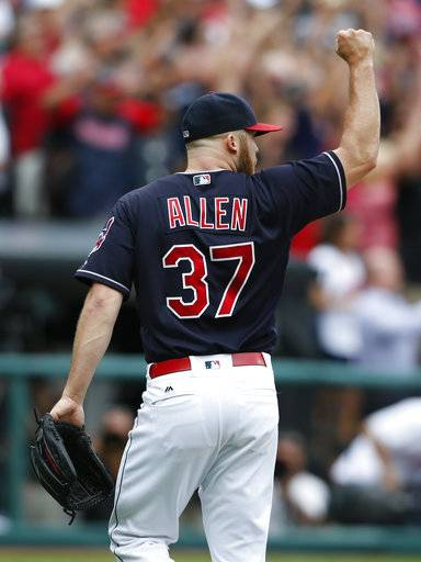 Cleveland Indians starting pitcher Cody Allen celebrates the last out of a 5-3 victory over the Detroit Tigers in a baseball game, Wednesday, Sept. 13, 2017, in Cleveland. The Indians set the American League record with 21 consecutive wins.