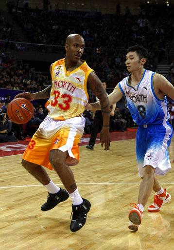 FILE - In this March 21, 2010, file photo, Stephon Marbury of China North team drives the ball down the court against Liu Wei of China South team, during the China Basketball Association's all-star game in Beijing.  Marbury hopes to finish off his basketball career back in the NBA. The 40-year-old guard is playing in the Chinese Basketball Association this season for the Beijing Fly Dragons and then when the league ends in February or March he wants to join an NBA franchise.
