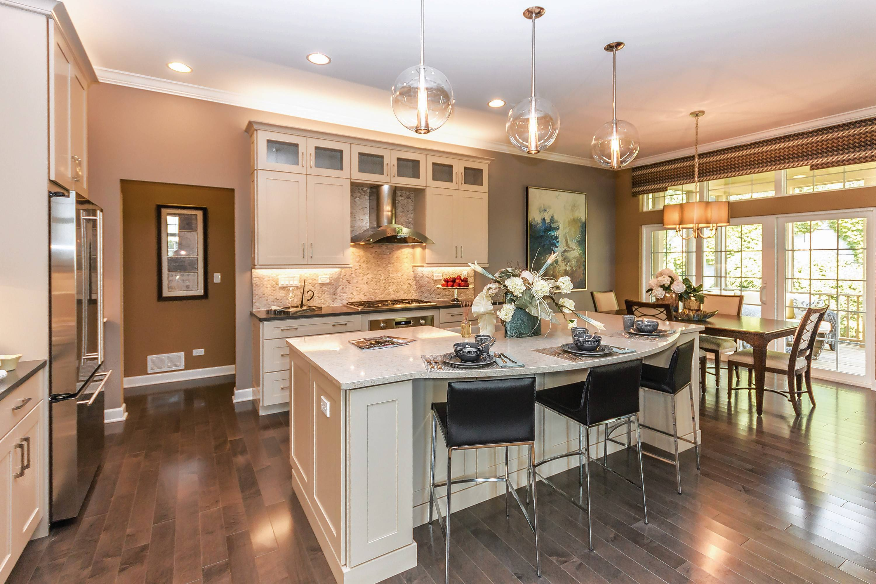 The kitchen is given a prominent spot in the open-concept floor plan. This is the Ashton model at Lakes at Boulder Ridge in Lake in the Hills.
