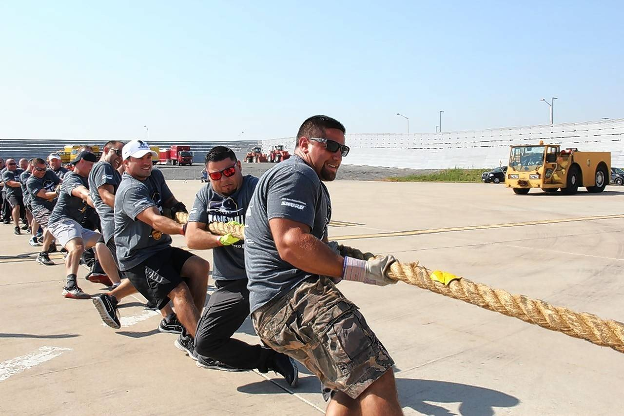 The Schaumburg Police Department team attempts the plane pull. Other Northwest Cook County teams participating included Arlington Heights, Buffalo Grove and Rosemont police.