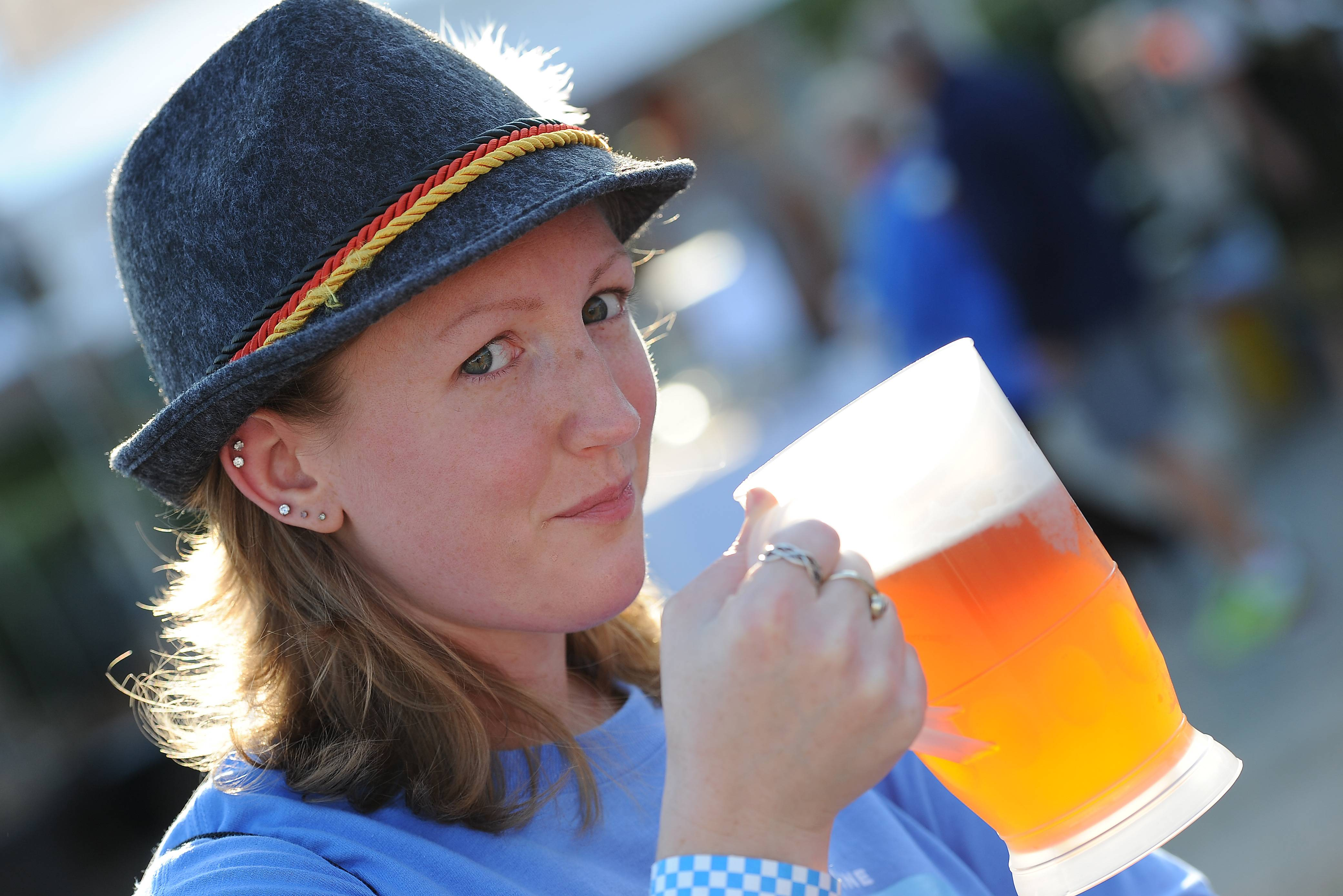 Deidre Crane, 29, of Lake Zurich samples the beer at the 10th annual Rotary Club of Palatine's Oktoberfest beer extravaganza on Friday.