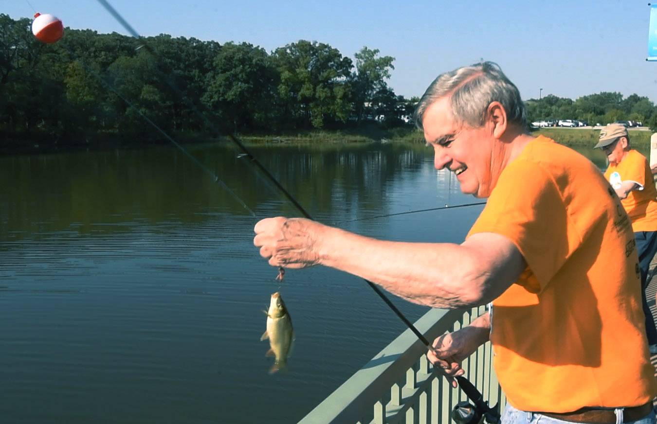 Ray Hilgenberg catches a fish while participating in the fishing derby during Friendship Village's 10th annual Silver Games in Schaumburg Friday.