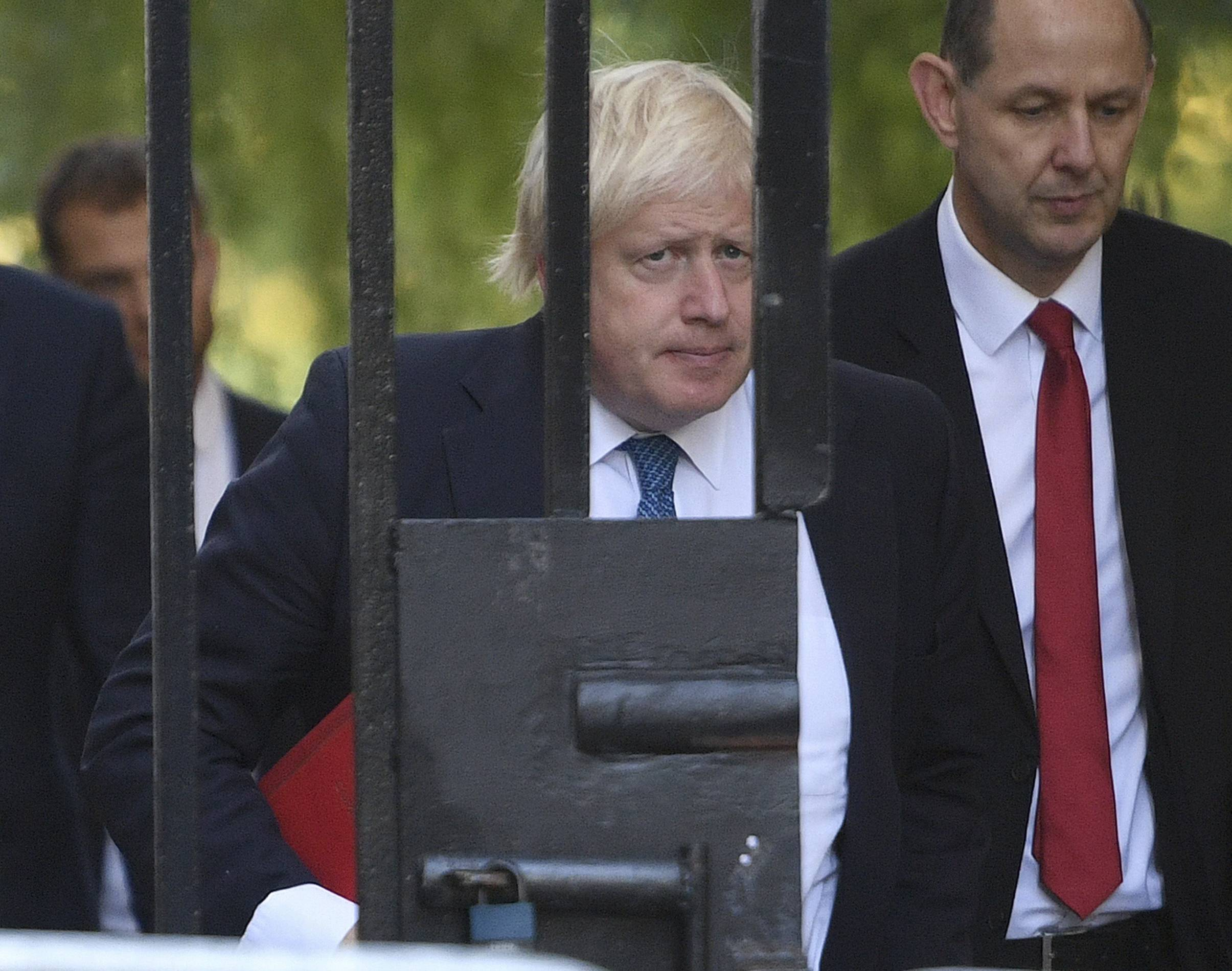 Britain's Foreign Secretary Boris Johnson arrives at Downing Street in London, following a terrorist attack at Parsons Green subway station in London, Friday, Sept. 15, 2017.  A bucket wrapped in an insulated bag caught fire on a packed London subway train early Friday, sending commuters running for safety at the height of the morning rush hour. (Victoria Jones/PA via AP)