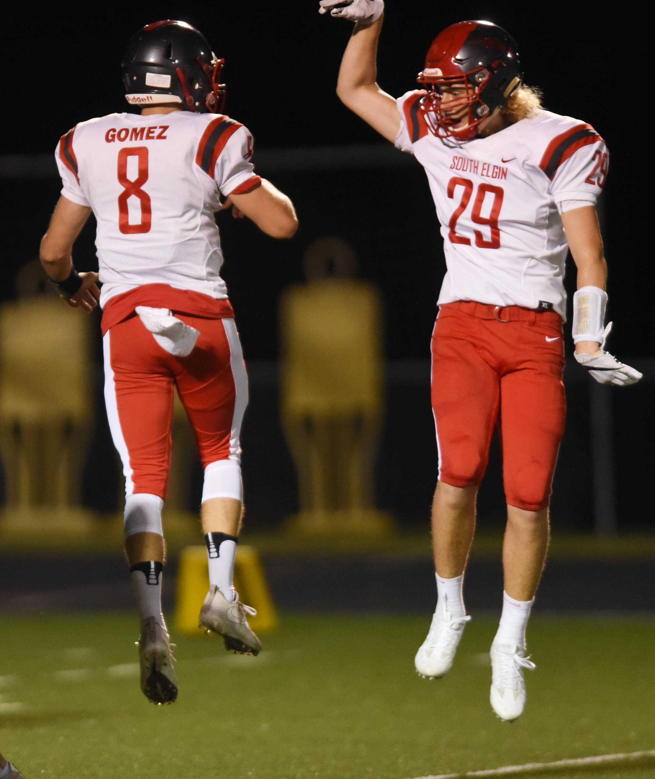 South Elgin quarterback Nate Gomez celebrates his first quarter touchdown run against Bartlett with Jake Donat Friday at Millennium Field in Streamwood.